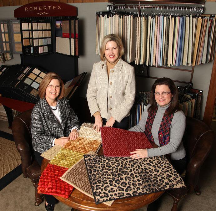 McAbee's Custom Carpet rug design consultation in front of Robertex display