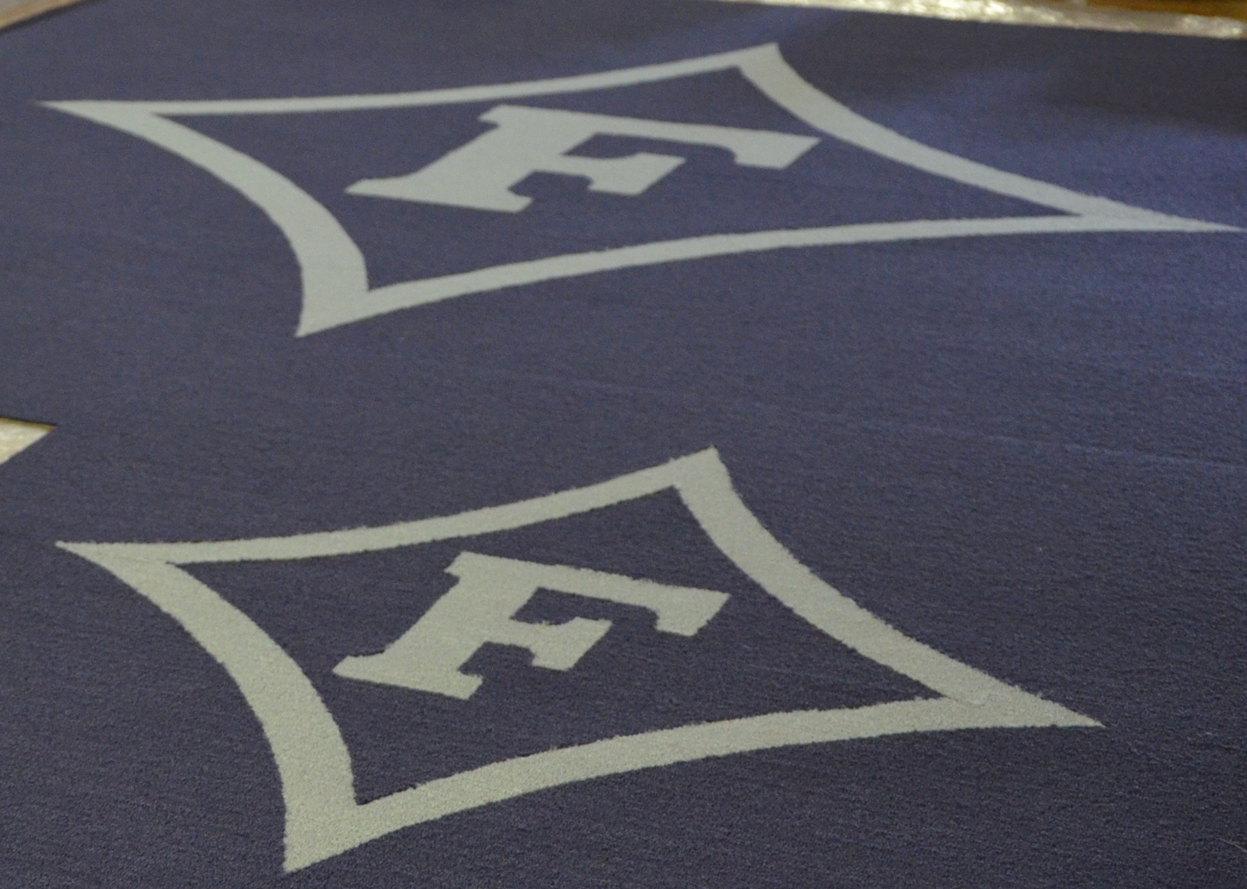 Custom manufactured carpet inserts for Furman University by McAbee's Carpet